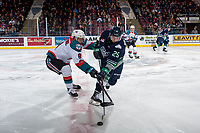 KELOWNA, CANADA - FEBRUARY 23:  Owen Williams #25 of the Seattle Thunderbirds takes a shot from centre ice as Marek Skvrne #9 of the Kelowna Rockets tries to block on February 23, 2018 at Prospera Place in Kelowna, British Columbia, Canada.  (Photo by Marissa Baecker/Shoot the Breeze)  *** Local Caption ***