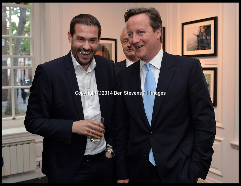 The Prime minister David Cameron with Photographer Andrew Parsons as he attends the opening of the Royalty, Politics and War: the art of the photojournalist Andrew Parsons Opening Night exhibition at the Ellwood Artfield Gallery, Westminster London, The images will be sold to raise money for Great Ormond Street Hospital after Andrew's daughter was diagnosed with leukaemia in August 2012, Tuesday, 13th May 2014. Picture by Ben Stevens / i-Images