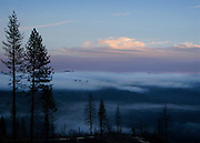 A clearing storm at dusk, as seen over the Stanislaus River canyon near Avery, California