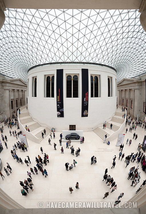 The distinctive Great Court at the British Museum in London. Designed by Foster and Partners, its formal name is the Queen Elizabeth II Great Court. It converted the Museum's inner courtyard into the largest covered public square in Europe. It encloses two acres, with the round reading room in the center.