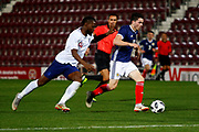 Lewis Morgan Scotland U21s (Celtic FC) breaks away from Joshua Onomah England U21s (Sheffield Wednesday, loan from Tottenham Hotspur) during the U21 UEFA EUROPEAN CHAMPIONSHIPS match Scotland vs England at Tynecastle Stadium, Edinburgh, Scotland, Tuesday 16 October 2018.