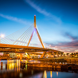 Boston Zakim Bunker Hill Bridge at night photo. The Leonard P. Zakim Bunker Hill Memorial Bridge is a cable bridge that spans the Charles River in Boston, Massachusetts in the Eastern United States.