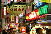 Exemplifying Japan's lively and adventurous food culture, Osaka's Dotomburi Street offers an all-squid eatery, an all-crab place, and a restaurant specializing in fugu (poisonous blowfish). Hungry Planet: What the World Eats (p. 184). This image is featured alongside the Ukita family images in Hungry Planet: What the World Eats.