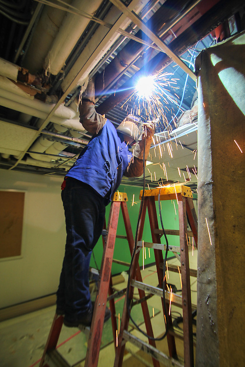 A worker completes some welding at Rusk Elementary School.