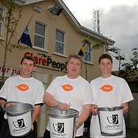 """26/08/05<br /> Liam Quinn, Offaly, Pj Murphy, Galway, who are members of Young Fine Gael with (centre) Fine Gael TD Pat Breen collecting money from motorists in Ennis as part of there walk from Galway to Limerick to raise funds and highlight the work of """"AWARE"""", who work to help combat depression in Ireland. <br /> Picture. Cathal Noonan/Press22."""