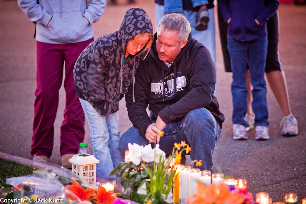 tucsonshooting - 09 JANUARY 2011 - TUCSON, AZ: Kayla Class (CQ) and her father, David Class (CQ) a memorial for Gabrielle Giffords at University Medical Center in Tucson Sunday night. Congresswoman Gabrielle Giffords, US Federal Judge John Roll and several other people were shot by a lone gunman in a mass shooting Saturday.     ARIZONA REPUBLIC PHOTO BY JACK KURTZ