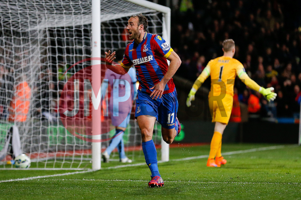 Glenn Murray of Crystal Palace celebrates scoring a goal to make it 1-0  as Manchester City players appeal to the referee - Photo mandatory by-line: Rogan Thomson/JMP - 07966 386802 - 06/04/2015 - SPORT - FOOTBALL - London, England - Selhurst Park - Crystal Palace v Manchester City - Barclays Premier League.