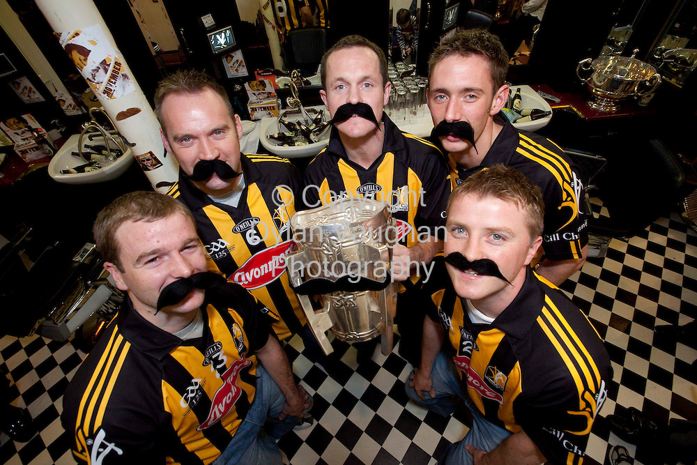 29/10/2009.Free picture no charge for use.The Kilkenny Hurling Team holding the temporarily renamed 'Mo Carthy Cup' get shaved down in Marble City Barbers, Kilkenny in preparation for the start of Movember. .Movember (the month formally known as November) starts this Sunday - Mo Bros and Mo Sistas should register on www.movember.com.Pictured at Marble City Barbers in Kilkenny are Kilkenny All Ireland players from left JJ Delaney, PJ Ryan, Michael Kavanagh, Michael Fennelly and Aidan Fogarty..Picture Dylan Vaughan..