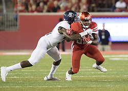 September 16, 2017 - Houston, TX, USA - Houston Cougars running back Patrick Carr (22) is tackled while carrying the ball during the third quarter of the college football game between the Houston Cougars and the Rice Owls at TDECU Stadium in Houston, Texas. (Credit Image: © Scott W. Coleman via ZUMA Wire)