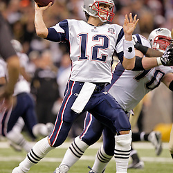 2009 November 30:  New England Patriots quarterback Tom Brady (12) passes the ball during a 38-17 win by the New Orleans Saints over the New England Patriots at the Louisiana Superdome in New Orleans, Louisiana.