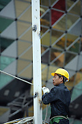A Chinese construction worker on the site of the new Lisboa Casino in central Macau.