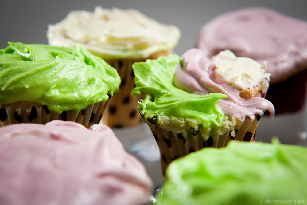 Cup cakes, lime green, pink and white frosting.