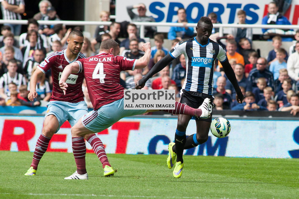 Kevin Nolan (West Ham) and Papiss Cisse (Newcastle) in the Newcastle v West Ham, Barclays Premiership match at St James&rsquo; Park, Newcastle 24 May 2014<br />