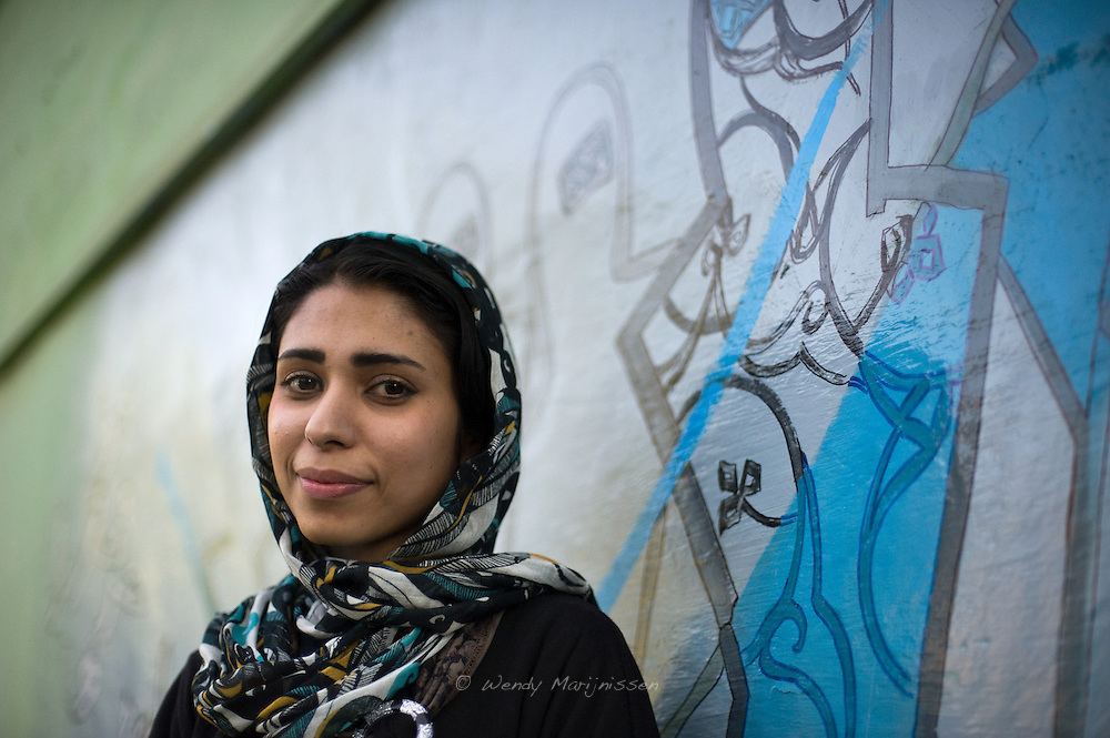 Shamsia Hassani, a young contemporary artist from Afghanistan. She is Afghanistan's first female graffiti artist, a member of the Roshd art collective and sculpture teacher at the Kabul University. Kabul, Afghanistan, 2012