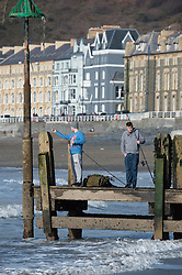 ©Licensed to London News Pictures 07/03/201 Aberystwyth. UK. People enjoying a day of warm sunny spring weather at the seaside in Aberystwyth on the west Wales coast. Photo credit: Keith Morris/LNP