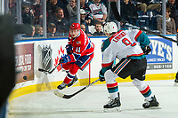 KELOWNA, CANADA - FEBRUARY 6: Jaret Anderson-Dolan #11 of the Spokane Chiefs passes the puck up the ice as Mark Liwiski #9 of the Kelowna Rockets checks during first period on February 6, 2019 at Prospera Place in Kelowna, British Columbia, Canada.  (Photo by Marissa Baecker/Shoot the Breeze)