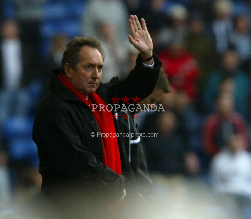 WEST BROMWICH, ENGLAND - Saturday, April 26, 2003: Liverpool's manager Ge?rard Houllier salutes the travelling fans as his side beat West Bromwich Albion 6-0 during the Premiership match at the Hawthorns. (Pic by David Rawcliffe/Propaganda)