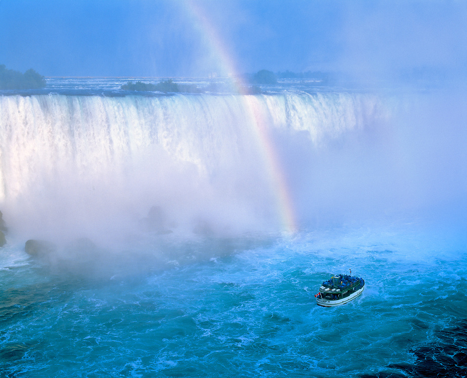 The Maid of the Mist glides through the churning water of Niagara Falls, New York.