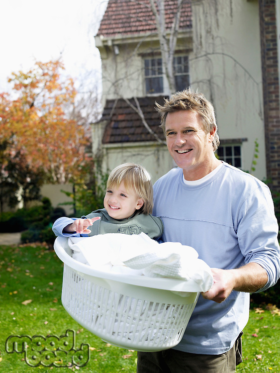 Father Carrying Son in Laundry Basket