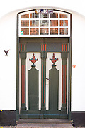 Traditional old-fashioned painted door in Gronnegade in medieval Ribe centre, South Jutland, Denmark