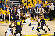 Golden State Warriors guard Stephen Curry (30) floats the ball into the basket against the Utah Jazz during Game 2 of the Western Conference Semifinals at Oracle Arena in Oakland, Calif., on May 4, 2017. (Stan Olszewski/Special to S.F. Examiner)
