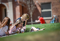 Students enjoy a warm day studying at Tucker Beach. Photo by Marc Hall