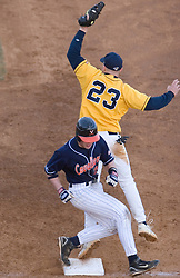 Virginia Cavaliers outfielder Brandon Guyer (20) beats an errant throw to first in action against GWU.  The Virginia Cavaliers Baseball Team defeated the George Washington University Colonials 15-2 to complete a sweep of the three game series on February 19, 2007 at Davenport Field, Charlottesville, VA.