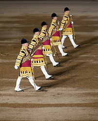 © Licensed to London News Pictures. LONDON, UK  09/06/11. Five bandmasters of the Guards Brigade march in formation during the annual Beating of the Retreat at Horse Guards Parade. On two successive evenings each year in June a pageant of military music, precision drill and colour takes place on Horse Guards Parade in the heart of London when the Massed Bands of the Household Division carry out the Ceremony of Beating Retreat. 300 musicians, drummers and pipers perform this age-old ceremony. The Retreat has origins in the early days of chivalry when beating or sounding retreat pulled a halt to the days fighting. Please see special instructions. Photo credit should read Matt Cetti Roberts/LNP. Please see special instructions for usage rates. Photo credit should read Matt Cetti-Roberts/LNP