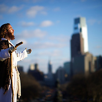 "With the Philadelphia skyline behind him, Michael Grant, 28, ""Philly Jesus,"" looks towards the afternoon sun on December 18, 2014.  Nearly everyday for the last 8 months, Grant has dressed as Jesus Christ, and walked the streets of Philadelphia to share the Christian gospel by example.  He quickly acquired the nickname of ""Philly Jesus,"" which he has gone by ever since. REUTERS/Mark Makela (UNITED STATES)"
