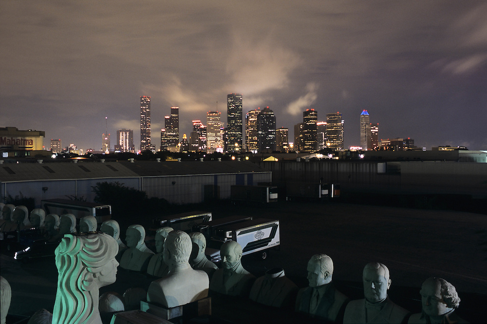 Houston, Texas skyline at night with artist's sculptures in the foreground.