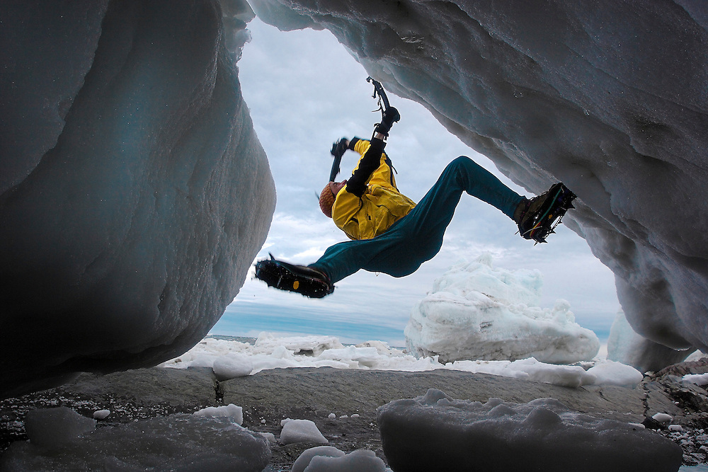 Stephane Lapierre, one of Quebec's climbing pioneer, ice bouldering on a frozen wave on the St. Lawrence river in Baie-des-Sables, Qc, Canada.