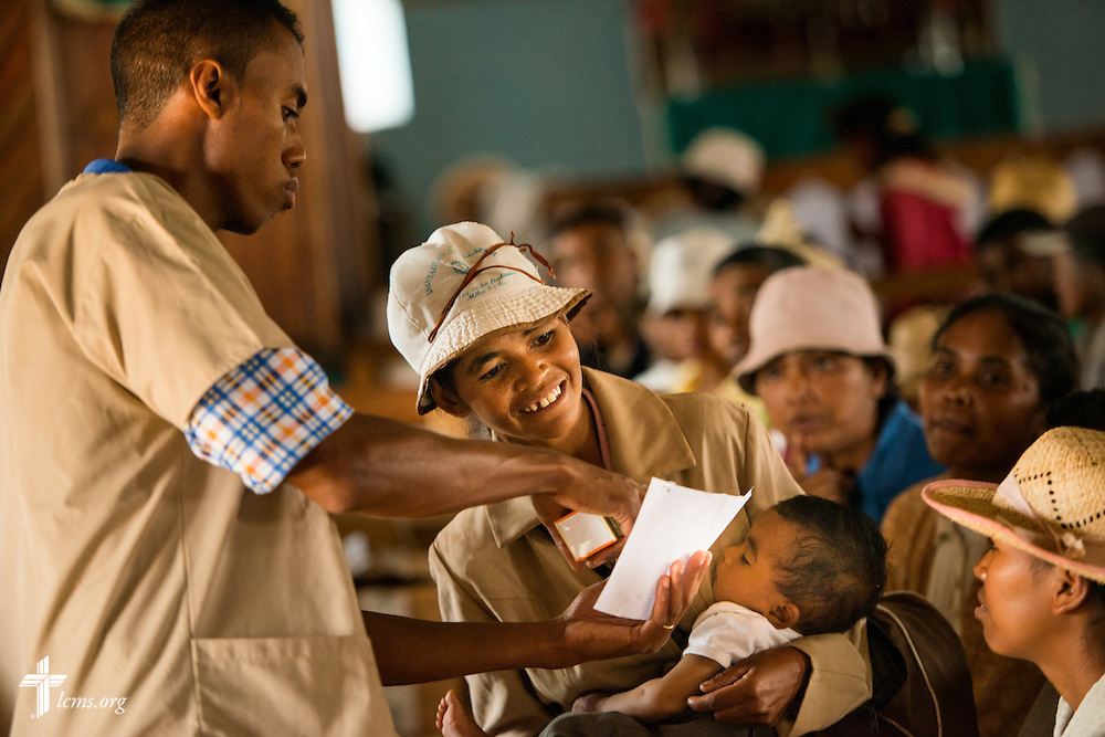 A patient receives a prescription during the Mercy Medical Team clinic on Saturday, Oct. 18, 2014, at a Fiangonana Loterana Malagasy (FLM) Lutheran church in Antsoantany, Madagascar. LCMS Communications/Erik M. Lunsford