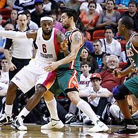 22 January 2012: Milwaukee Bucks small forward Carlos Delfino (10) defends on Miami Heat small forward LeBron James (6) during the Milwaukee Bucks 91-82 victory over the Miami Heat at the AmericanAirlines Arena, Miami, Florida, USA.