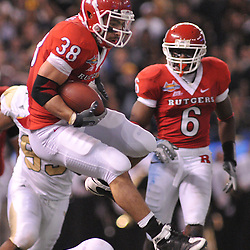 Dec 19, 2009; St. Petersburg, Fla., USA; Rutgers running back Joe Martinek (38) leaps over a defender during NCAA Football action in Rutgers' 45-24 victory over Central Florida in the St. Petersburg Bowl at Tropicana Field.