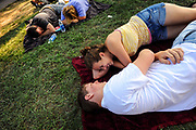 Relaxing on the lawn outside the main pavilion, Amber Crowley, 16, and Justin Martin, 18, of Pasadena, Md., said they came to the music festival to see headliner Blink-182.