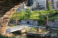 Minneapolis, USA - Aug 12, 2015: Mill Ruins Park in Minneapolis, Minnesota. Mill Ruins Park is a park in downtown Minneapolis, Minnesota, United States, standing on the west side of Saint Anthony Falls on the Mississippi River. The park interprets the history of flour milling in Minneapolis and shows the ruins of several flour mills that were abandoned.