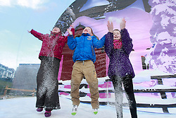 No fee for Repro: 22/01/2012.Cara Cardiff (6) from Ballyboden, Dillon (4) and Ava Blake (8) from Rathfarnham are pictured in a giant snow globe during World Snow Day at the Ski Club of Ireland in Kilternan who hosted a festival day of snowsports activities. Pic Andres Poveda.