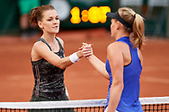 Paris, France - 2017 May 30: (L) Agnieszka Radwanska from Poland thanks for the game to (R) Fiona Ferro from France after their women's single match first round during tennis Grand Slam tournament The French Open 2017 (also called Roland Garros) at Stade Roland Garros on May 30, 2017 in Paris, France.<br /> <br /> Mandatory credit:<br /> Photo by © Adam Nurkiewicz<br /> <br /> Adam Nurkiewicz declares that he has no rights to the image of people at the photographs of his authorship.<br /> <br /> Picture also available in RAW (NEF) or TIFF format on special request.<br /> <br /> Any editorial, commercial or promotional use requires written permission from the author of image.