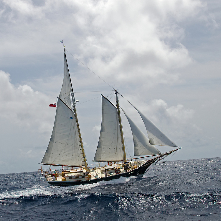 """Back in the 60s, classic yachts, which were gathered in English Harbour Antigua, had begun chartering and the captains and crews challenged each other to a race down to Guadeloupe and back to celebrate the end of the charter season. From this informal race, Antigua Race Week was formalised in 1967, and in those days all of the yachts were classics. As the years grew on, the classic yachts were slowly outnumbered but the faster sleeker modern racing yachts and 24 years later the Classic Class had diminished to a few boats and was abandoned in 1987. However this same year seven classic yachts turned out and were placed in Cruising Class 3 with the bare boats. The class was so unmatched that it was downright dangerous, so Captain Uli Pruesse hosted a meeting onboard Aschanti of Saba with several classic skippers and in 1988 the Antigua Classic Yacht Regatta was born, with seven boats.<br /> <br /> In 1991, Elizabeth Meyer brought her newly refitted Endeavour and Baron Edmond Rothschild brought his 6-meter Spirit of St Kitts and """"CSR"""" became the first Sponsor and inaugurated the Concours d'Elégance. In 1996 we created the """"Spirit of Tradition Class"""", which has now been accepted all over the world, which gives the """"new"""" classics, built along the lines of the old, a chance to sail alongside their sister ships. In 1999 we celebrated the first race between the J class yachts in 60 years. Mount Gay Rum has sponsored the Regatta for many years, and we have recently added Officine Panerai as our first ever Platinum Sponsor.<br /> <br /> The Antigua Classic Yacht Regatta has maintained a steady growth, hosting between 50 and 60 yachts every year and enjoys a wonderful variety of competitors, including traditional craft from the islands, classic ketches, sloops, schooners and yawls making the bulk of the fleet, together with the stunningly beautiful Spirit of Tradition yachts, J Class yachts and Tall Ships."""