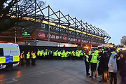 Stewards line up to hold back Argyle fans to allow the visiting Portsmouth buses to leave during the EFL Sky Bet League 1 match between Plymouth Argyle and Portsmouth at Home Park, Plymouth, England on 9 February 2019.