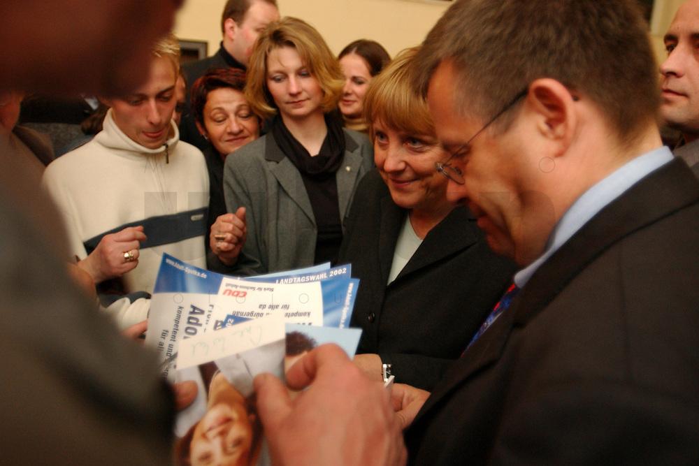 10 APR 2002, BERNBURG/GERMANY:<br /> Angela Merkel, CDU Bundesvorsitzende, schreibt Autogramme, nach einem Wahlkampfauftritt im Vorfeld der Landtagswahl Sachsen-Anhalt, Kurhaus Bernburg<br /> IMAGE: 20020410-01-040<br /> KEYWORDS: Wahlkampf, Veranstaltung, Wahlkampfveranstaltung, Autogrammkarte