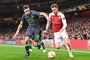 Arsenal Midfielder Aaron Ramsey (8) and  Sporting Lisbon Defender Sebastian Coates (4) in action during the Europa League group stage match between Arsenal and Sporting Lisbon at the Emirates Stadium, London, England on 8 November 2018.