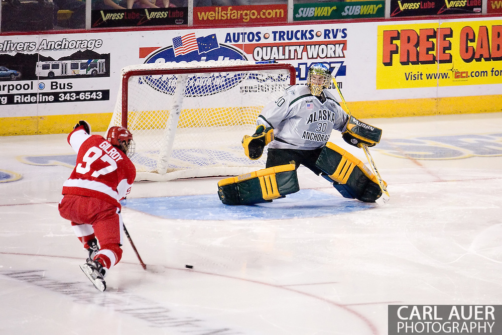 October 13, 2007 - Anchorage, Alaska:  Goalie Jon Olthuis (30) of the University of Alaska-Anchorage Seawolves is slow to react to the shot from Matt Gilroy (97) of the Boston University Terriers giving BU a 3-2 lead in the second period of game 4 of the Nye Frontier Classic at the Sullivan Arena.  UAA and BU would tie 4-4 giving Robert Morris University the title of Nye Frontier Classic Champion.