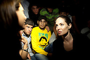 Jordan: UNHCR Special Envoy Angelina Jolie meets with refugees on the Jordanian border minutes after they crossed from Syria. With shelling clearly audible and visible across the border in Syria, some 200 refugees made the dangerous crossing under cover of night. ..Authorities estimate hundreds of families are fleeing the violence and seeking safety across the border every night....©UNHCR/JTanner/Sept 2012