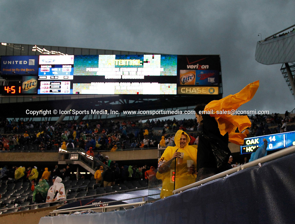 Nov. 17, 2013 - Chicago, IL, USA - Fans are evacuated from the stadium due to a severe storm that stopped the Chicago Bears game against the Baltimore Ravens at Soldier Field in Chicago on Sunday, Nov. 17, 2013