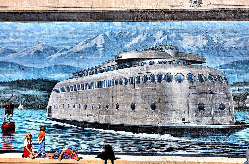 Kalakala Ferry Mural by Cory Ench in Port Angeles, Washington<br /> Artist Cory Ench created this Motor Vessel Kalakala Ferry mural in Port Angeles, Washington. The painting is a tribute to the steel, art deco ferry that served the Puget Sound from 1935 to 1967. Its unique, streamlined appearance with the round portholes made it popular with tourists for a while. However, its strong vibrations resulted in uncomplimentary nicknames like the Silver Slug. The ship retired in 1967. After multiple owners and users, it is currently moored in Tacoma, Washington, where its fate hinges on multiple lawsuits.
