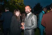 ANNABELLE ROTHSCHILD; EVGENY LEBEDEV, Serpentine Summer party 2012 sponsored by Leon Max. Pavilion designed by Herzog & de Meuron and Ai Weiwei. Kensington Gardens. London. 26 June 2012.