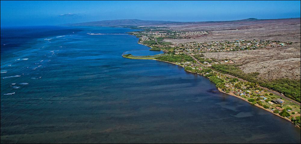 Southern coast of Molokai, Hawaii showing fishpond and Kaunakakai Wharf.