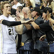 Central Florida forward P.J. Gaynor (21) celebrates with spectators folowing a Conference USA NCAA basketball game between the Marshall Thundering Herd and the Central Florida Knights at the UCF Arena on January 5, 2011 in Orlando, Florida. Central Florida won the game 65-58 and extended their record to 14-0.  (AP Photo/Alex Menendez)