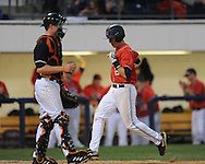 Mississippi's Alex Yarbrough (2) scores past Tennessee catcher Blake Forsythe in a college baseball at Oxford-University Stadium on Friday, April 2, 2010 in Oxford, Miss. Ole Miss won 7-3.